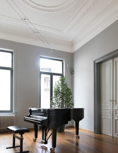 living area with grand piano
